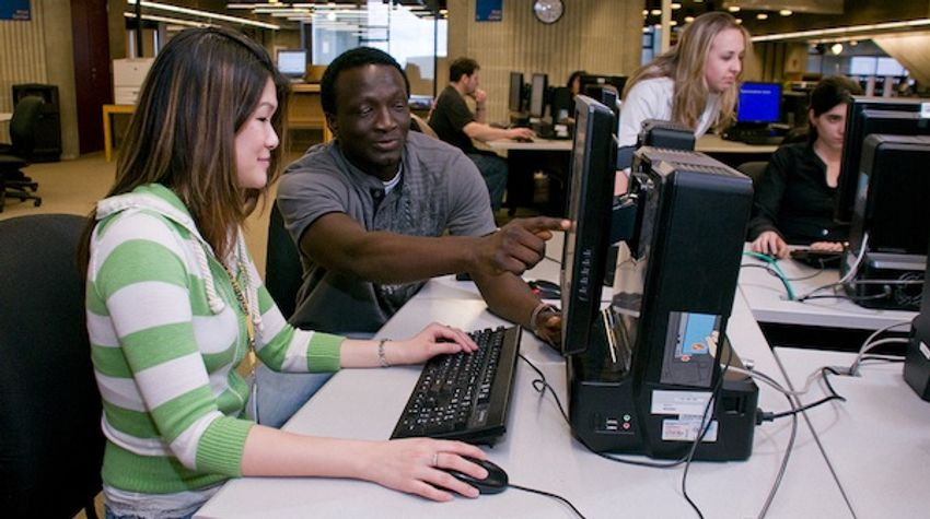 CITS helping student in computer lab