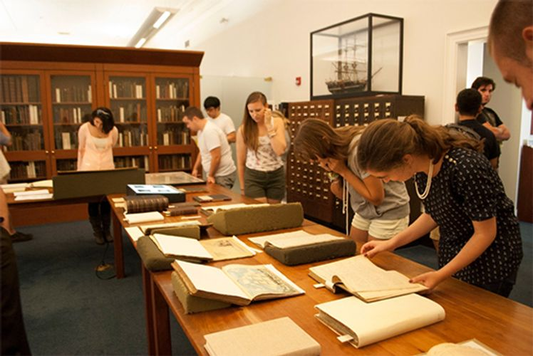 Art History students visit the visual collections of the Whaling Museum archives in New Bedford.